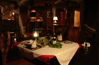 dining in the tent with canvas walls zippered up